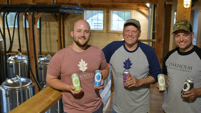 Oakholm owners, brewer Andrew Woodward, Rick Predella and son Chris Predella in the renovated barn which is not open to the public yet.  But it has been open for can pickup and has a food truck on the weekends.