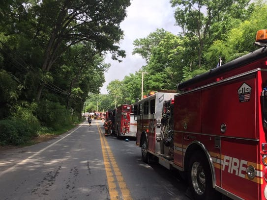 Trucks line up on Craley Road as crews battle a large
