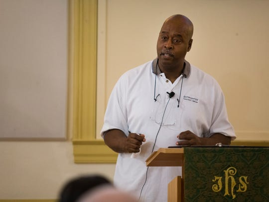 Senior pastor at Newark United Methodist Church Rev. Derrick Porter gives a sermon on race and racism during the Sunday morning service.