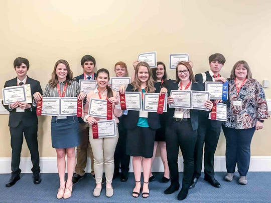 Winners pose with their certificates in Clarksville. Note: not all students who placed are pictured.