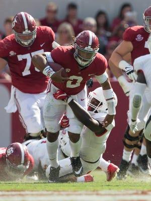Alabama quarterback Jalen Hurts (2) tackled by Fresno State Bulldogs defender at Bryant-Denny Stadium.