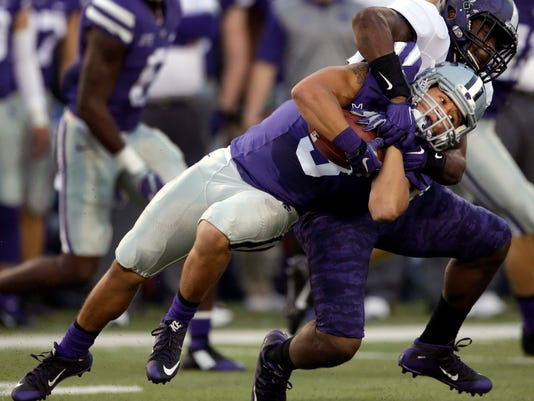 Kansas State kick-return specialist Dalvin Warmack (3) is tackled by TCU special teams player Alec Dunham during the first half of an NCAA college football game in Manhattan, Kan., Saturday, Oct. 10, 2015. (AP Photo/Orlin Wagner)