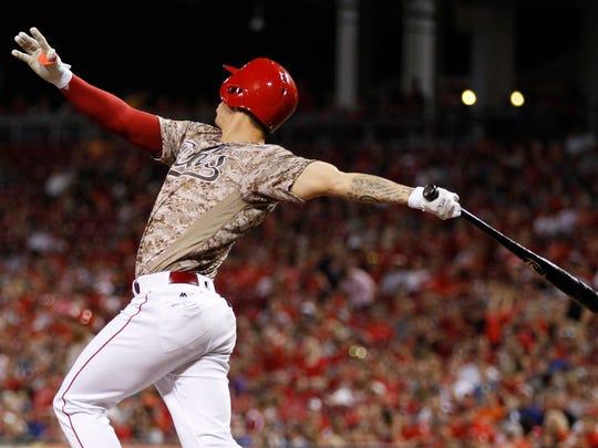 Cincinnati Reds' Michael Lorenzen follows through on a three-run home run off Los Angeles Dodgers relief pitcher Pedro Baez during the seventh inning of a baseball game, Friday, Aug. 19, 2016, in Cincinnati. It was Lorenzen's first career home run.