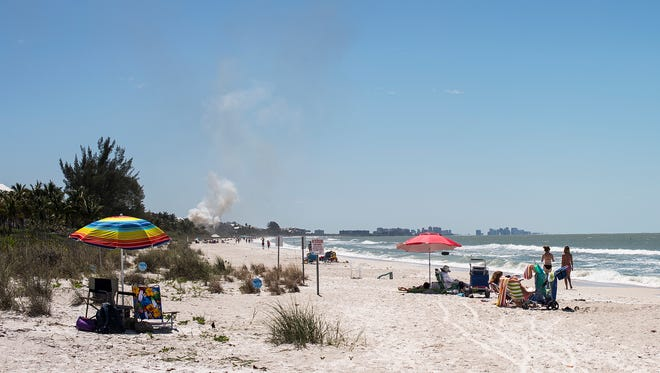 Smoke is seen from a fire near Hickory Boulevard in Bonita Springs on Friday, April 7, 2017.