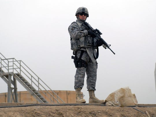 In this 2009 photo,Sgt. 1st Class Chad McNeal of Marksville, with the Louisiana Army National Guard?s 225th Engineer Brigade in Pineville, stands guard at an oil refinery in Baghdad, Iraq. He is among the more than 25,000 Louisiana National Guardsmen who have deployed in the Global War on Terrorism.