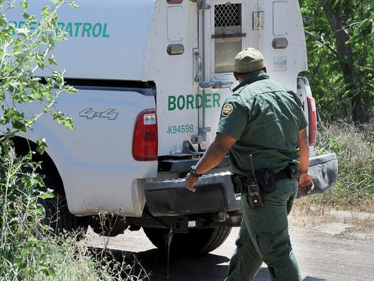 A U.S. Border Patrol Agent returns to his vehicle after checking the scene of a brush fire along the Rio Grande River in Brownsville, Texas, Wednesday, April 5, 2017.