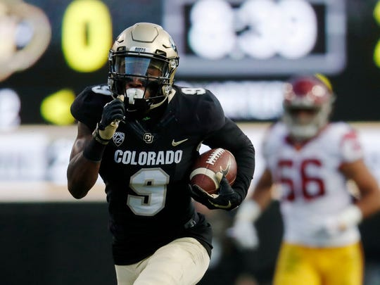 Colorado wide receiver Juwann Winfree, front, runs for a touchdown past USC linebacker Jordan Iosefa after Winfree pulled in a pass in the second half of an NCAA college football game Saturday, Nov. 11, 2017, in Boulder, Colo. USC won 38-24.