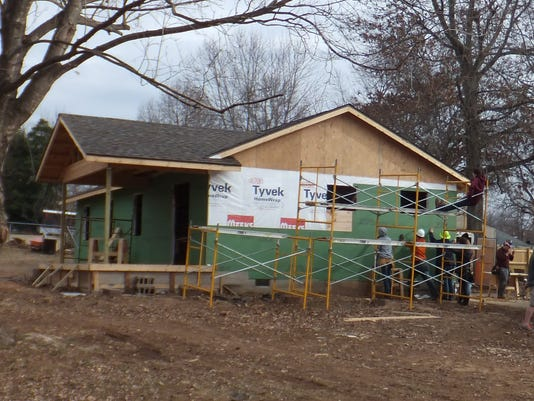 Nixa HS building trades 4 - putting sheeting on house in preparation for sid.JPG