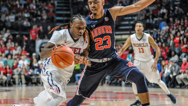 Mississippi guard Stefan Moody (42) drives the lane against Auburn  guard TJ Lang (23) during the first half of an NCAA college basketball game at the Pavilion at Ole Miss on Wednesday, Jan. 27, 2016.