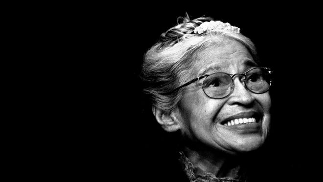 In this Nov. 28, 1999, file photo, Rosa Parks smiles during a ceremony where she received the Congressional Medal of Freedom in Detroit, Mich. The 60th anniversary of the Montgomery bus boycott is widely credited with helping spark the modern civil rights movement when Parks refused to give up her bus seat to a white man.
