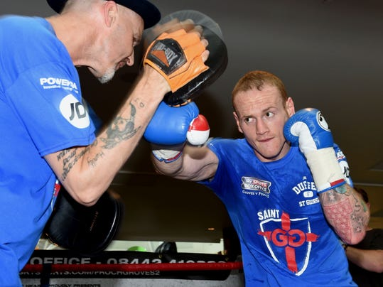 In this photo taken  Tuesday May 27, 2014 British boxer George Groves in action during a workout at the Westfield Shopping Centre, London.  Labeled as one of the biggest boxing fights in British history, the second instalment of Carl Froch vs. George Groves is on course to live up to the considerable hype. Saturdayís contest for Froch's IBF and WBA super-middleweight titles has all the ingredients of a classic _ an iconic location of Wembley Stadium, a record British crowd for a boxing match of 78,000, a national great coming up against a young pretender and a score to settle after a controversial first fight. (AP Photo/Simon Cooper/PA)  UNITED KINGDOM OUT