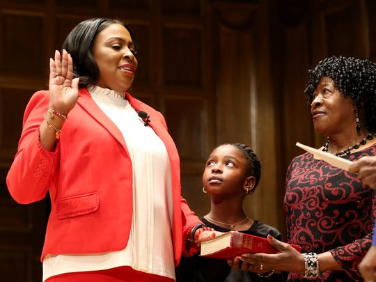 Mayor Lovely Warren is sworn in with her daughter, Taylor Granison, and mother, Elrita Warren, at her side at her second inauguration.