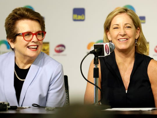 """Billie Jean King, left, and Chris Evert, right, smile as they talk to reporters at the Miami Open tennis tournament in Key Biscayne, Fla., Wednesday, March 23, 2016. King and Evert talked about the resignation of the tournament director of the BNP Paribas Open, who said women's pro tennis players """"ride on the coattails of the men."""" (AP Photo/Alan Diaz)"""