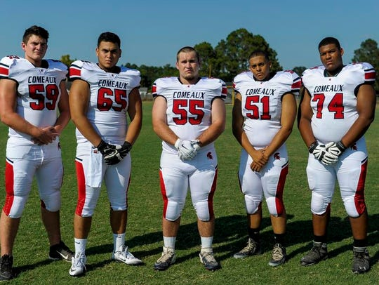 Comeaux's offensive line of Tyler May (59), Alejandre