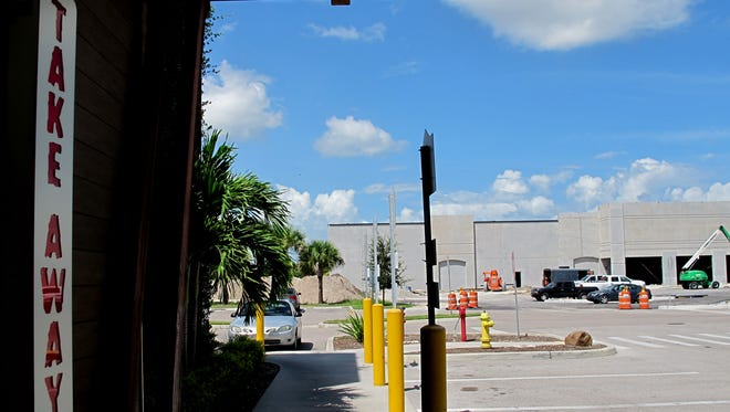 "A 55,000-square-foot Hobby Lobby store is under construction Friday, Aug. 6, 2016, behind the ""Take Away"" area of Outback Steakhouse, left, on U.S. 41 East in East Naples."