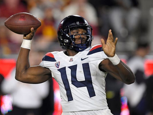 Arizona quarterback Khalil Tate throws a pass during the first half of an NCAA college football game against Southern California, Saturday, Nov. 4, 2017, in Los Angeles. (AP Photo/Mark J. Terrill)