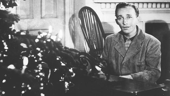 "Bing Crosby sings ""White Christmas"" in the 1942 movie ""Holiday Inn."""