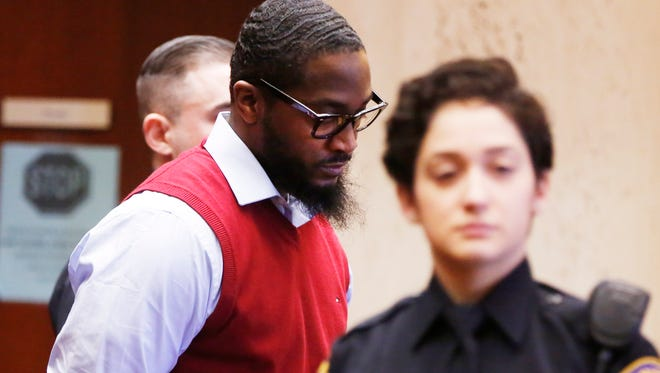 Basim Henry, left, is lead into court as the jury hearing his case enters its second day of deliberations Thursday, March 30, 2017, Newark.