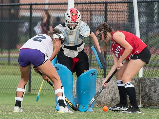 Two Bennett field hockey players practice a drill on Monday, Sept. 18, 2017.