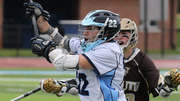 Suffern midfielder Radu Stancescu (22) went 17 for 20 on faceoffs and kept the offense rolling in a 16-3 win over Clarkstown South.