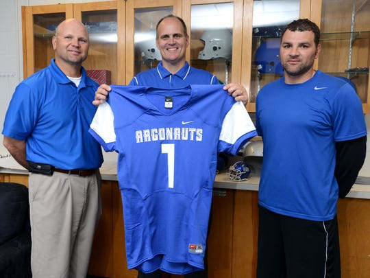 University of West Florida Football Head Coach Pete Shinnick, center, Assistant Coach Steve Saulnier, left, and Offensive Coordinator Jammie Deese pictured in a 2014 photo. Deese announced he would leave his position  on Monday.