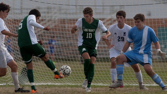 Long Branch's Diego Galiz boots in his team's second goal in their 2-0 win. Long Branch Boys soccer vs Manasquan in SCT Tournament game in Sea Girt, NJ on October 22, 2015