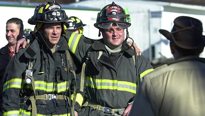 Christopher Stimpson, left, of Scarsdale and Michael Geller of Long Beach at the Westchester Fire Training Center in Valhalla in 2002.