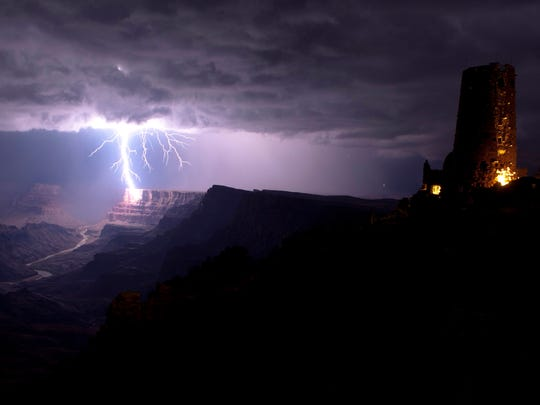 A lightning strike illuminates the Grand Canyon's South Rim near Desert View Watchtower.