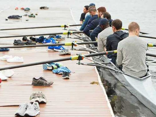 Young men row a crew ship