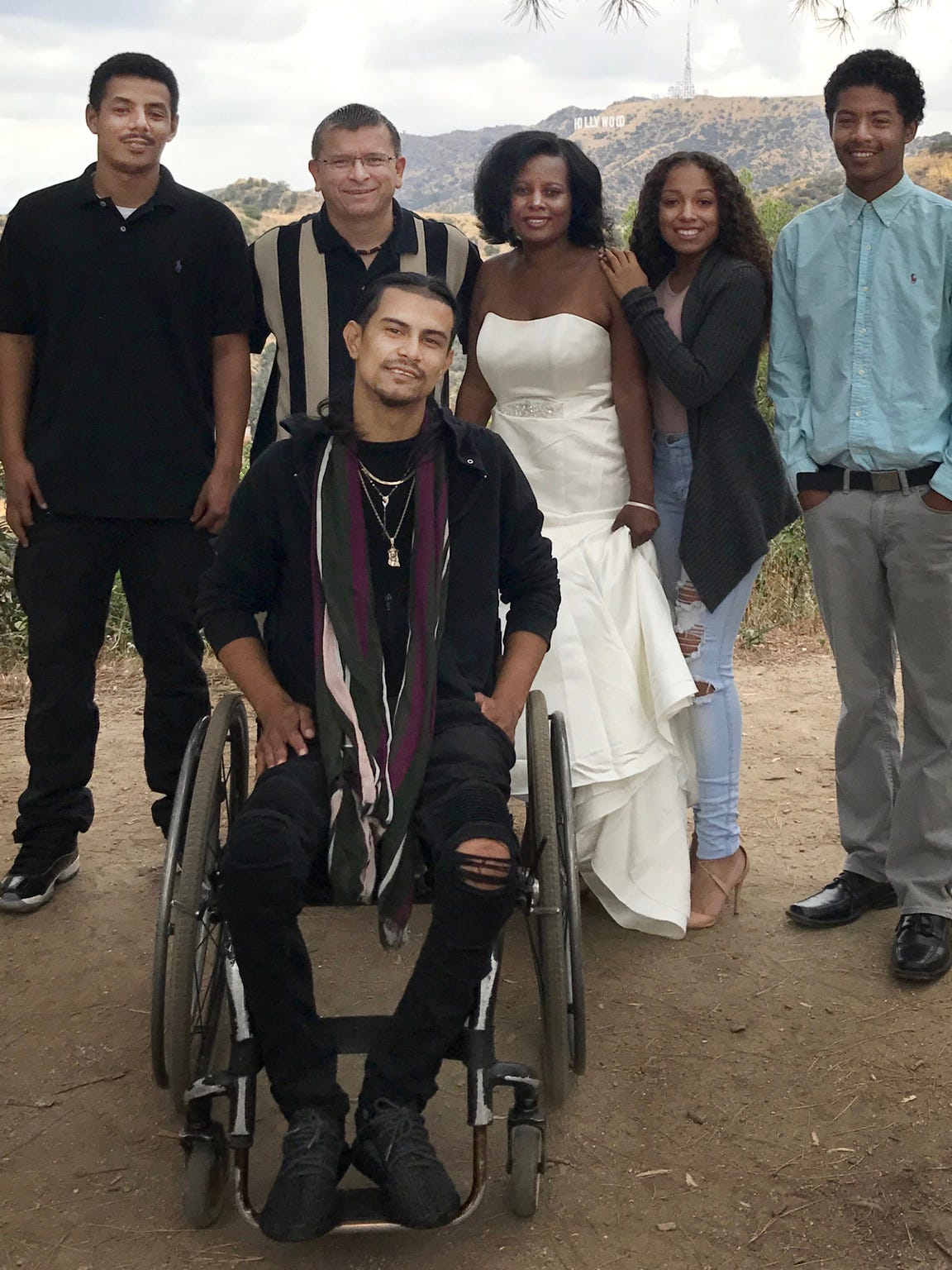 Javier Arango was best man at the 2017 wedding of his mentor, Ricardo Peña (striped shirt), who is flanked by his wife and children. Peña helped Arango find work and support after Arango decided he wanted to quit gang banging.