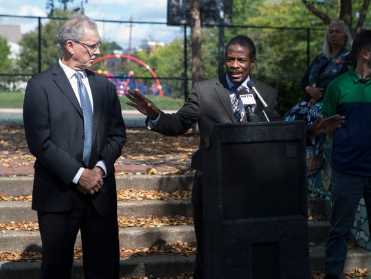 District 1 City Councilman Nnamdi Chukwuocha speaks at the dedication for a new mosaic created by the Creative Vision Factory at Helen Chambers Park.