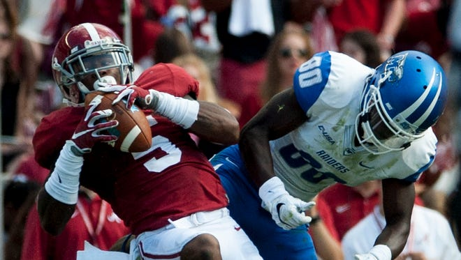 Alabama defensive back Cyrus Jones (5) intercepts a pass intended for Middle Tennessee's Ed Batties (80) at Bryant-Denny Stadium in Tuscaloosa, Ala. on Saturday September 12, 2015.