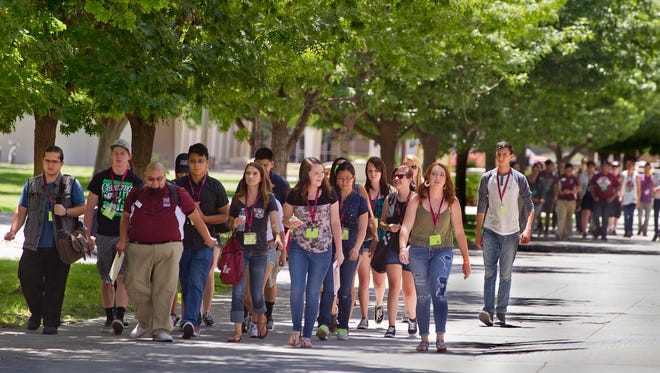 Groups of new NMSU students make their way around the NMSU campus during orientation Saturday afternoon on NMSU's campus, 6/11/16