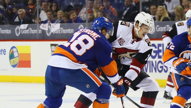 Ryan Strome #18 of the New York Islanders skates against his brother Dylan Strome #20 of the Arizona Coyotes during the first period at the Barclays Center on October 21, 2016 in the Brooklyn borough of New York City.