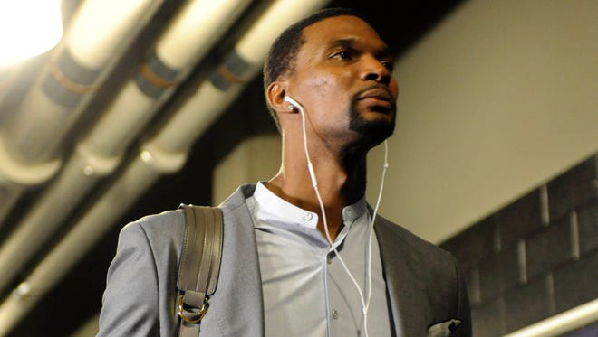 Chris Bosh arrives at the arena before Game 6 of the first round of the NBA Playoffs against the Charlotte Hornets.