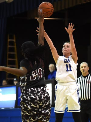 CAK's Amber Heatherly (11) shoots a three-pointer over Fulton's Tink White (24) to give CAK a brief 17-16 lead during a high school basketball game at Christian Academy of Knoxville in Knoxville on Friday, Feb. 26, 2016.