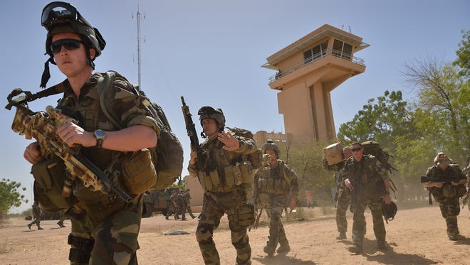 French legionnaires patrol at Timbuktu airport on Jan. 30 as they prepare to board a plane to return to their base in Abidjan.