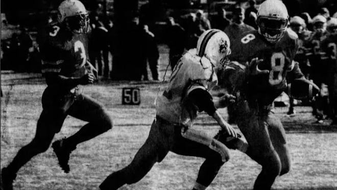 Howard Wakkinen of Conrad (3) looks to make a block for quarterback Bart Becker (8) in a Cowboys' playoff game against Glasgow in October of 1995. Wakkinen is a Top 10 selection for Conrad in the Tribune's GOAT Football Series.
