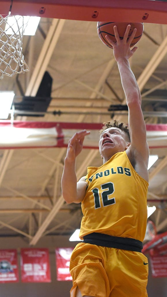 Reynolds'  Isaiah Pruett goes up for a shot during the championship game of the WMAC tournament at Erwin High School on Friday, Feb. 16, 2018. The Rockets defeated the Blackhawks 68-52 to win the conference title.