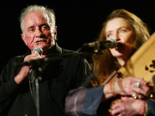 Country music legend Johnny Cash performs with his wife, June Carter Cash, at the first Americana Awards show in Nashville on Sept. 13, 2002. The Man in Black died in 2003 at the age of 71.