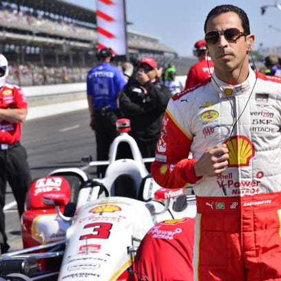 Helio Castroneves prepares for practice on Carb. Day