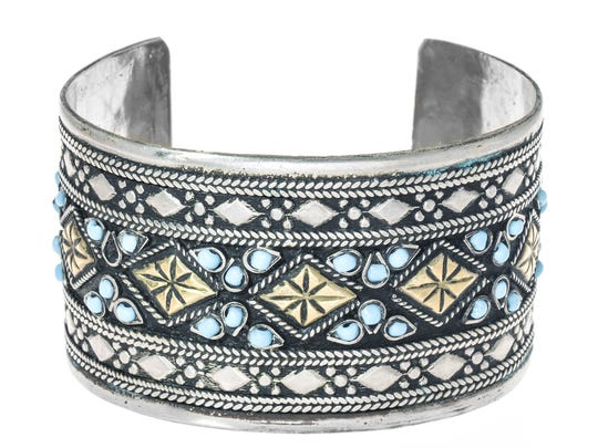 This turquoise and silver bracelet went to the winner