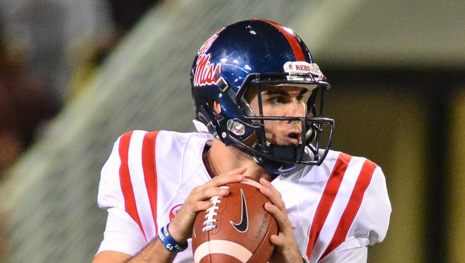 Quarterback Chad Kelly (10) drops back in the pocket during the game against the Mississippi State Bulldogs at Davis Wade Stadium. Ole Miss won 38-27. Mandatory Credit: Matt Bush-USA TODAY Sports