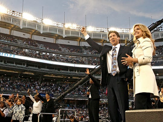 Joel Osteen, center, with wife Victoria Osteen, followed in his father's steps and became a preacher, although he refused to do so for many years. His first sermon was given just days before his father died of a heart attack.