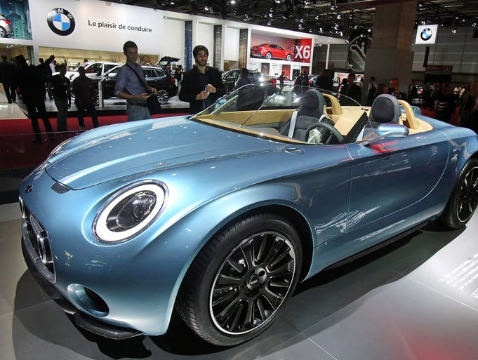 A Mini Superleggera is presented at the Paris Motor Show, in Paris, Friday Oct. 3, 2014. The Paris Motor Show will open its doors to the public on Saturday Oct. 4, until Oct. 19.  European carmakers are hoping to impress with new models at this week's Paris Motor Show and prove they have come out stronger from years of economic trouble and cost-cutting. (AP Photo/Remy de la Mauviniere)