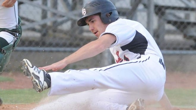 J.T. Bateman slides home with a run for North Buncombe on Thursday night.