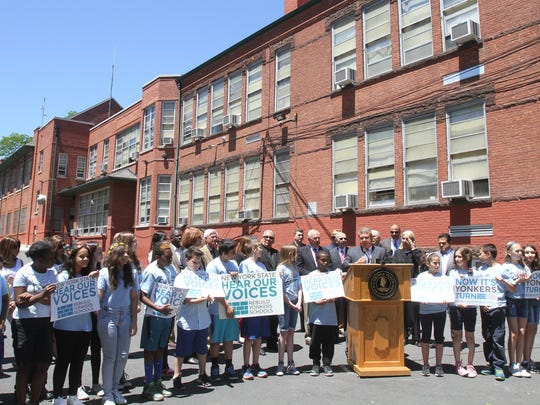 Yonkers Mayor Mike Spano standing with students outside the Patricia DiChiaro School on Bronxville Road in Yonkers.