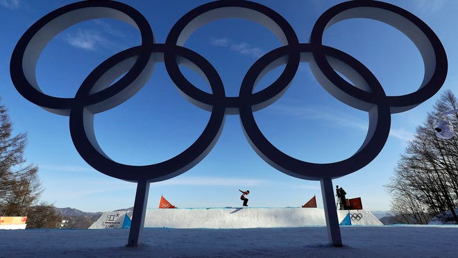 CarleBrenneman, of Canada, starts her training run prior to the women's snowboard cross qualifying at Phoenix Snow Park at the 2018 Winter Olympics in Pyeongchang, South Korea, Friday, Feb. 16, 2018. (AP Photo/Gregory Bull)