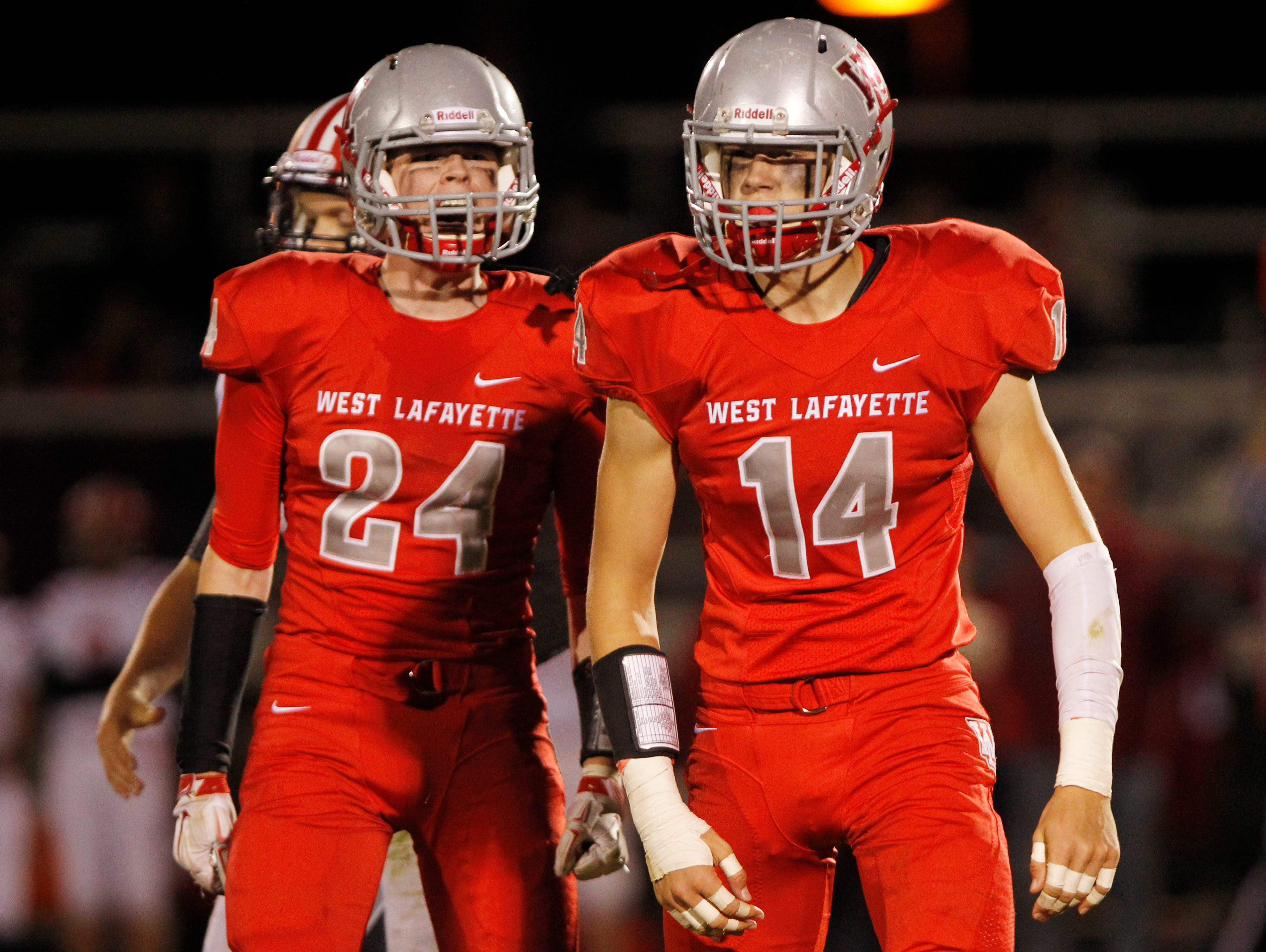 Sam Oates (24) and Frank Bodi (14) react after Bodi tackled Connor Cain of Twin Lakes for a loss in the third quarter Friday, October 9, 2015, in West Lafayette. West Lafayette defeated Twin Lakes 56-6.
