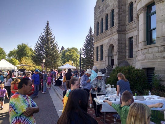 Attendees mill about at the 2015 Arts on Fire, an annual